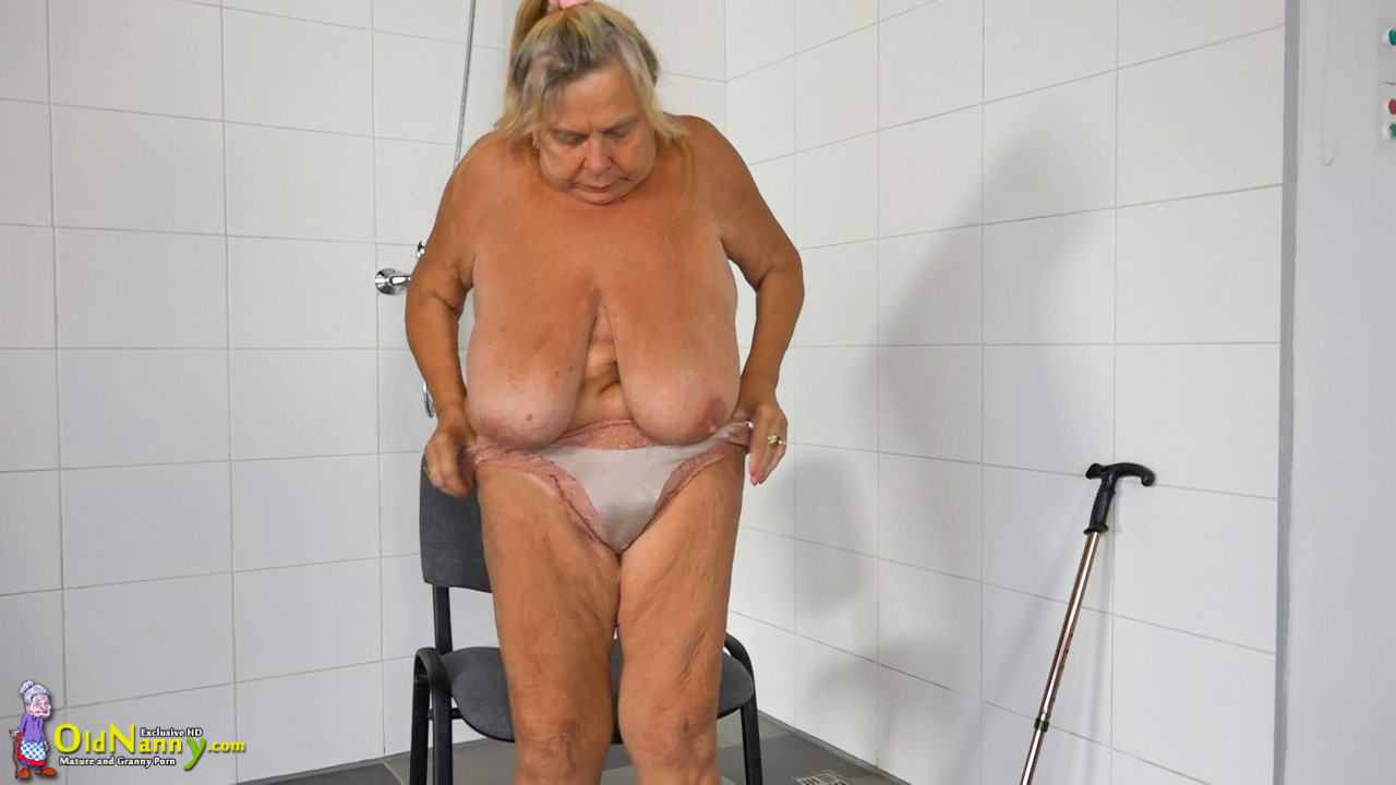Big-titted elderly dame is jacking in the douche